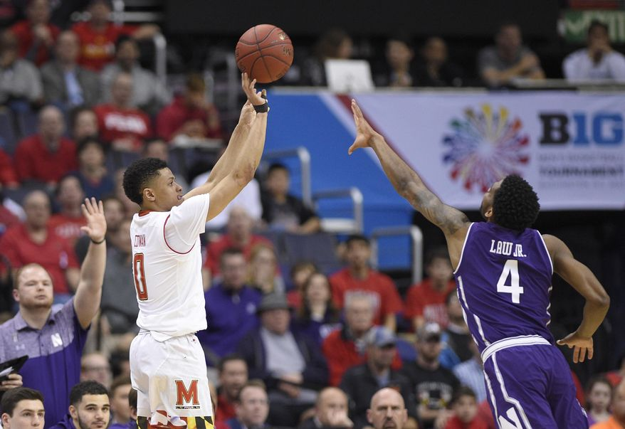 Maryland guard Anthony Cowan (0) shoots over Northwestern forward Vic Law (4) during the first half of an NCAA college basketball game in the Big Ten tournament, Friday, March 10, 2017, in Washington. (AP Photo/Nick Wass) **FILE**