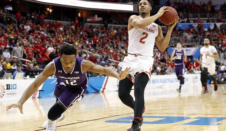 Northwestern guard Isiah Brown (12) lunges for the ball as Maryland guard Melo Trimble (2) drives to the basket during the first half of an NCAA college basketball game in the Big Ten tournament, Friday, March 10, 2017, in Washington. (AP Photo/Alex Brandon)