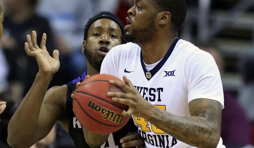 West Virginia forward Elijah Macon (45) looks for help while covered by Kansas State forward D.J. Johnson (4) during first half of an NCAA college basketball game in the semifinals of the Big 12 tournament in Kansas City, Mo., Friday, March 10, 2017. (AP Photo/Orlin Wagner)