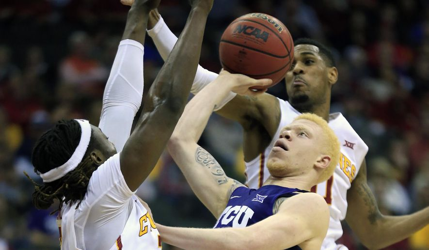 TCU guard Jaylen Fisher (0) shoots while covered by Iowa State's Ray Kasongo (3) and Monte Morris, back, during first half of an NCAA college basketball game in the semifinals of the Big 12 tournament in Kansas City, Mo., Friday, March 10, 2017. (AP Photo/Orlin Wagner)