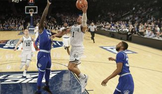 Villanova's Jalen Brunson (1) drives past Seton Hall's Ismael Sanogo (14) and Madison Jones (30) during the first half of an NCAA college basketball game during the Big East men's tournament Friday, March 10, 2017, in New York. (AP Photo/Frank Franklin II)