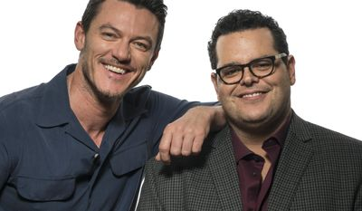 """This March 5, 2017 photo shows Luke Evans , left, and Josh Gad at the press junket for their film, """"Beauty and the Beast"""" at the Montage Hotel in Beverly Hills, Calif. (Photo by Ron Eshel/Invision/AP)"""