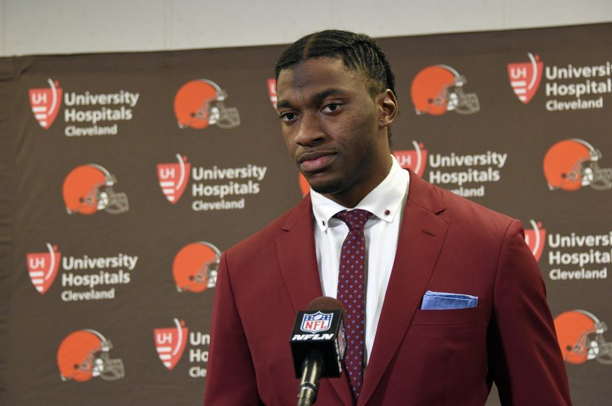 FILE - In this Jan. 1, 2017, file photo, Cleveland Browns quarterback Robert Griffin III is shown during a press conference following an NFL football game against the Pittsburgh Steelers, in Pittsburgh. A person familiar with the decision says the Cleveland Browns are releasing quarterback Robert Griffin III after one injury-marred season. Griffin is being let go one day before he would have been due a $750,000 roster bonus, said the person who spoke Friday, March 10, 2017,  to the Associated Press on condition of anonymity because the team has not announced the move. (AP Photo/Don Wright, File)