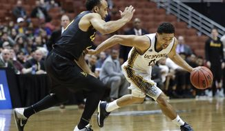 UC Irvine's Jaron Martin, right, drives under pressure by Long Beach State's Evan Payne during the second half of an NCAA college basketball game at the Big West men's tournament Friday, March 10, 2017, in Anaheim, Calif. UC Irvine won 62-57. (AP Photo/Jae C. Hong)