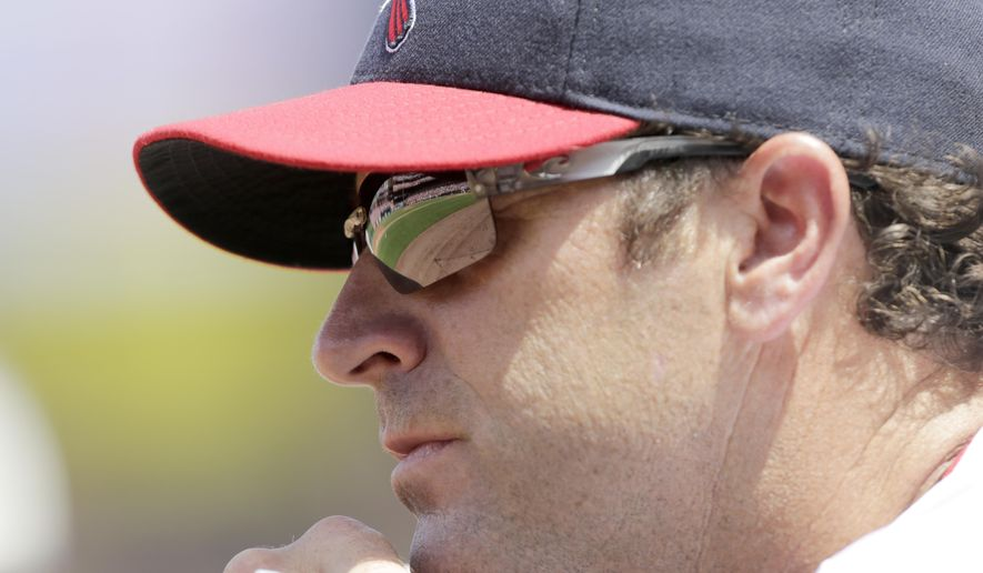"FILE - In this Aug. 7, 2016, file photo, St. Louis Cardinals manager Mike Matheny watches from the dugout in the second inning of a baseball game against the Atlanta Braves in St. Louis. Matheny has taken on a new role this spring, the Cardinals' self-proclaimed ""glove breakerinner guy,"" working over new leather during his spare time. (AP Photo/Tom Gannam, File)"