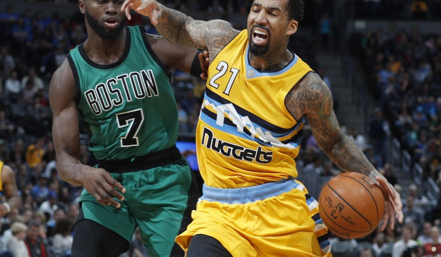 Denver Nuggets forward Wilson Chandler, right, drives past Boston Celtics forward Jaylen Brown in the first half of an NBA basketball game Friday, March 10, 2017, in Denver. (AP Photo/David Zalubowski)