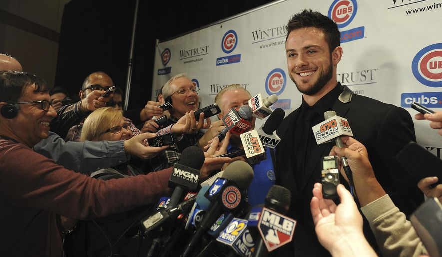 FILE - In this Jan. 13, 2017, file photo, Chicago Cubs' Kris Bryant laughs with interviewers at the Cubs Convention in Chicago. NL MVP Kris Bryant and the Cubs have agreed to a one-year contract worth $1.05 million in the major leagues, a record for an unsigned player under club control with less than two years of major league service. The agreement, announced Thursday, March 9, 2017, tops Mike Trout's $1 million salary with the Los Angeles Angels in 2014. (Mark Welsh/Daily Herald via AP, File)