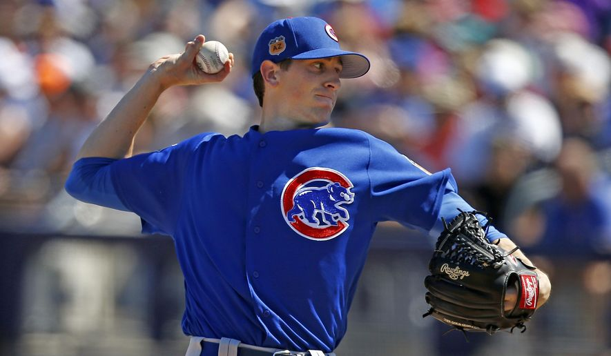 Chicago Cubs starting pitcher Kyle Hendricks throws to a Seattle Mariners batter during the first inning of a spring training baseball game Friday, March 10, 2017, in Peoria, Ariz. (AP Photo/Ross D. Franklin)