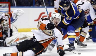 Anaheim Ducks' Logan Shaw, left, falls as he chases after a loose puck along side St. Louis Blues' Dmitrij Jaskin (23), of Russia, during the second period of an NHL hockey game Friday, March 10, 2017, in St. Louis. (AP Photo/Jeff Roberson)