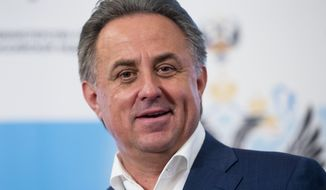 FILE - In this Sunday, July 24, 2016, file photo, Russian Sports Minister Vitaly Mutko speaks to the media in Moscow, Russia. People with knowledge of the decision say Russia World Cup head Vitaly Mutko has been barred from seeking re-election to FIFA's top decision-making body after failing an eligibility check. (AP Photo/Pavel Golovkin, File)