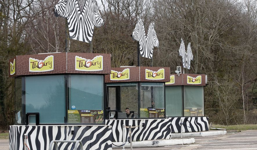 View of the entrance of the Thoiry Zoo, near Paris, France, Wednesday, March 8, 2017, where a rhinoceros named Vince was killed and one of it's horns removed using a chain saw. A zoo director says a 5-year-old rhinoceros at the wildlife park he runs near Paris, had been shot three times in the head by assailants who stole the animal's horn, it's carcass being found Tuesday. (AP Photo/Christophe Ena)