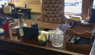Arnold Palmer's desk is shown at Bay Hill Club & Lodge in Orlando, Fla., Wednesday, March 8, 2017. A bottle of Musk Monsieur is still on his desk, the cologne that always announced Arnold Palmer was near. Next to it is plastic cups that hold pens he used to sign thousands of autographs. For the most part, everything is just as Palmer left it when he packed up last year and headed north to his Pennsylvania home for the summer. Only this time, he didn't return. (AP Photo/Doug Ferguson)