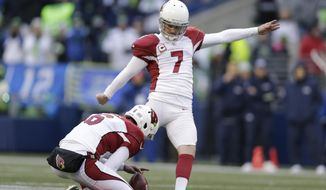 In this Saturday, Dec. 24, 2016 file photo, Arizona Cardinals kicker Chandler Catanzaro kicks with punter Matt Wile holding against the Seattle Seahawks in the second half of an NFL football game in Seattle. The New York Jets have signed free agent kicker Chandler Catanzaro and offensive tackle Kelvin Beachum. The team announced both moves Friday night, March 10, 2017, the second day of the NFL's free agency period. (AP Photo/John Froschauer, File)