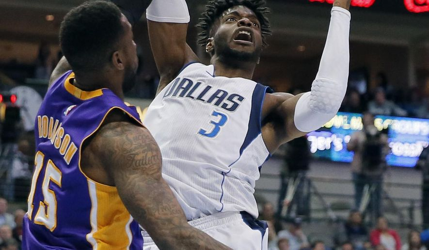 Los Angeles Lakers' Thomas Robinson (15) defends as Dallas Mavericks' Nerlens Noel (3) goes up for a shot in the second half of an NBA basketball game in Dallas, Tuesday, March 7, 2017. (AP Photo/Tony Gutierrez)