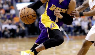 Los Angeles Lakers guard D'Angelo Russell (1) drives past Phoenix Suns guard Tyler Ulis during the first half of an NBA basketball game, Thursday, March 9, 2017, in Phoenix. (AP Photo/Matt York)