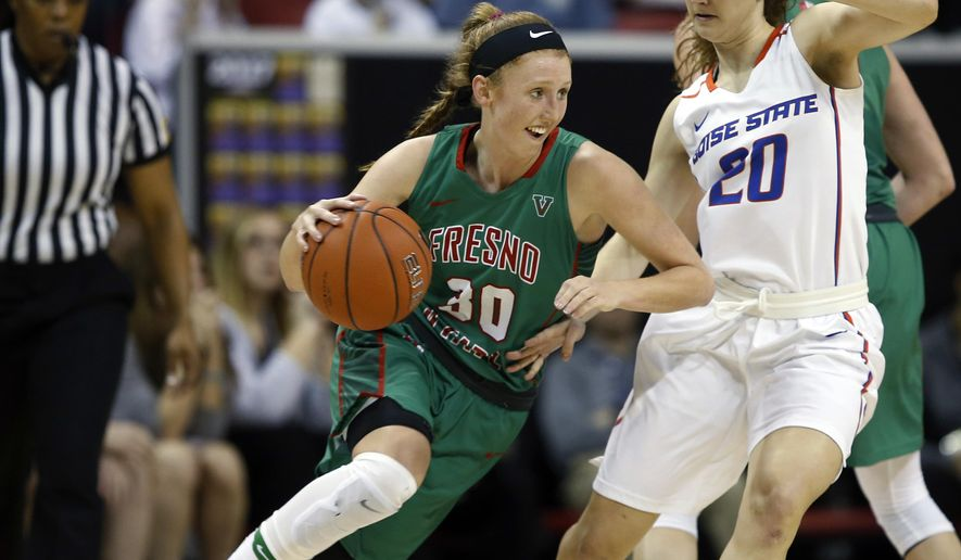 Fresno State's Kristina Cavey drives past Boise State's Marta Hermida during the first half of an NCAA college basketball game in the Mountain West Conference tournament Friday, March 10, 2017, in Las Vegas. (AP Photo/Isaac Brekken)