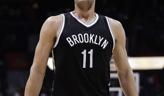 Brooklyn Nets' Brook Lopez looks up to the scoreboard during the final minutes of the team's NBA basketball game against the Atlanta Hawks in Atlanta, Wednesday, March 8, 2017. Atlanta won 110-105. (AP Photo/David Goldman)