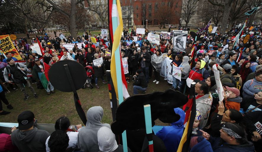 America Indians and their supporters rally in Lafayette Park across from the White House in Washington, Friday, March 10, 2017, against continued construction of the disputed Dakota Access pipeline.  (AP Photo/Manuel Balce Ceneta)