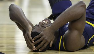 California's Jabari Bird lies on the floor after hitting his head on the court during the first half of an NCAA college basketball game against Oregon in the semifinals of the Pac-12 tournament Friday, March 10, 2017, in Las Vegas. Bird was injured on the play. (AP Photo/John Locher)