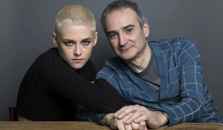 "Kristen Stewart, left, and writer-director Olivier Assayas pose for a portrait to promote their film, ""Personal Shopper,"" on Thursday, March 9, 2017, in New York. (Photo by Amy Sussman/Invision/AP)"