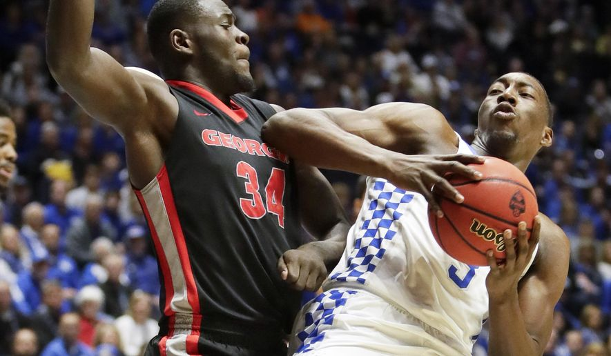 Georgia forward Derek Ogbeide (34) defends against Kentucky forward Edrice Adebayo (3) during the first half of an NCAA college basketball game at the Southeastern Conference tournament Friday, March 10, 2017, in Nashville, Tenn. (AP Photo/Wade Payne)