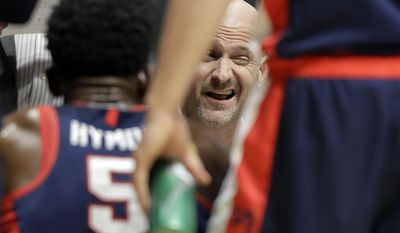 Mississippi head coach Andy Kennedy talks with his team during a timeout in the first half of an NCAA college basketball game against Arkansas at the Southeastern Conference tournament Friday, March 10, 2017, in Nashville, Tenn. (AP Photo/Wade Payne)