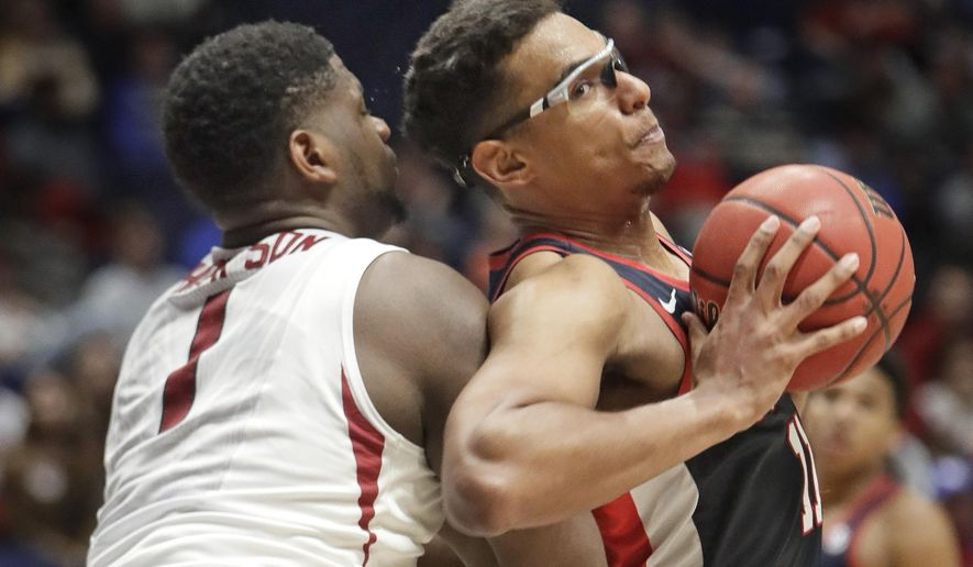 Mississippi forward Sebastian Saiz, right, leans into Arkansas forward Trey Thompson (1) during the second half of an NCAA college basketball game at the Southeastern Conference tournament Friday, March 10, 2017, in Nashville, Tenn. (AP Photo/Wade Payne)