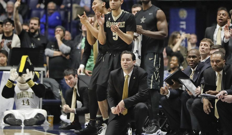 Vanderbilt head coach Bryce Drew, front center, and his team watch the action during overtime in an NCAA college basketball game against Florida at the Southeastern Conference tournament Friday, March 10, 2017, in Nashville, Tenn. Vanderbilt upset Florida 72-62. (AP Photo/Mark Humphrey)