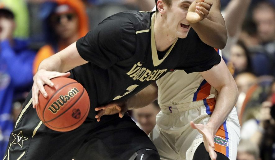 Vanderbilt forward Luke Kornet (3) drives against Florida forward Keith Stone during the second half of an NCAA college basketball game at the Southeastern Conference tournament Friday, March 10, 2017, in Nashville, Tenn. (AP Photo/Wade Payne)
