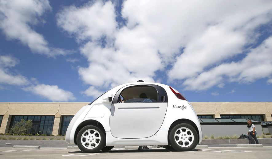 FILE - In this May 13, 2015, file photo, Google's new self-driving prototype car is introduced at the Google campus in Mountain View, Calif. Cars with no steering wheel, no pedals and nobody at all inside could be driving themselves on California roads by the end of 2017, under proposed new rules that would give a powerful boost to the technology from the nation's most populous state. (AP Photo/Tony Avelar, File)