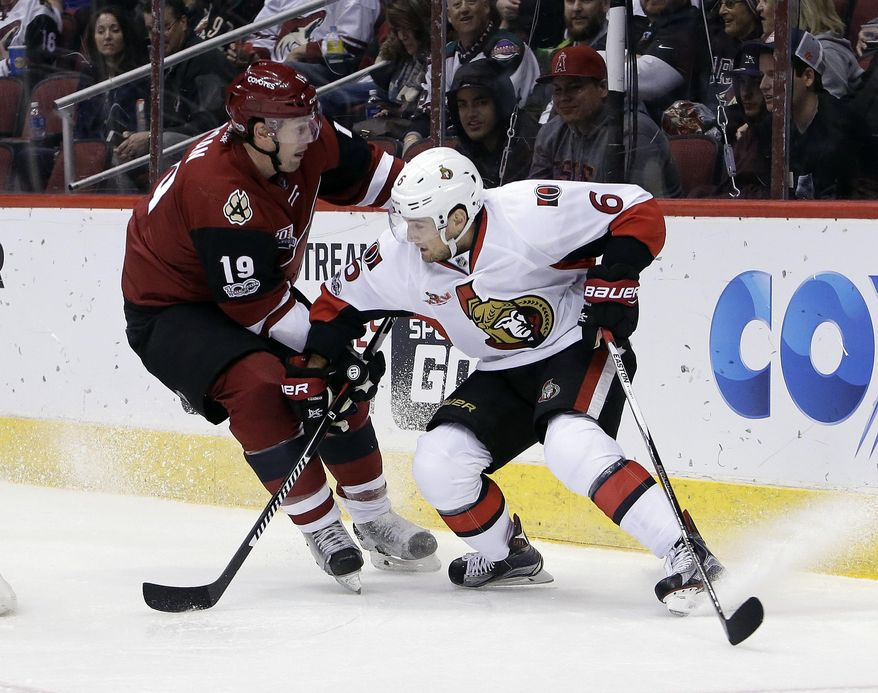 Arizona Coyotes right wing Shane Doan (19) and Ottawa Senators defenseman Chris Wideman skate for the loose puck during the second period during an NHL hockey game, Thursday, March 9, 2017, in Glendale, Ariz. (AP Photo/Rick Scuteri)
