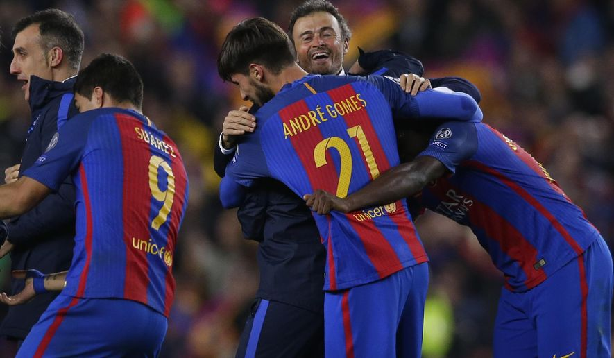 Barcelona's head coach Luis Enrique celebrates with some of his players at the end of the Champions League round of 16, second leg soccer match between FC Barcelona and Paris Saint Germain at the Camp Nou stadium in Barcelona, Spain, Wednesday March 8, 2017. Barcelona won the match 6-1 (6-5 on aggregate). (AP Photo/Manu Fernandez)