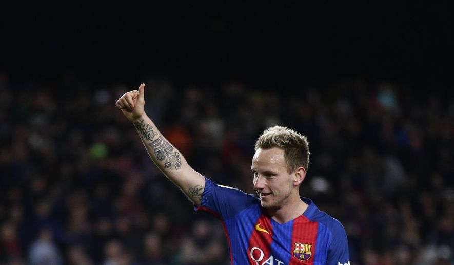 FC Barcelona's Ivan Rakitic celebrates after scoring during the Spanish La Liga soccer match between FC Barcelona and Celta Vigo at the Camp Nou in Barcelona, Spain, Saturday, March 4, 2017. (AP Photo/Manu Fernandez)