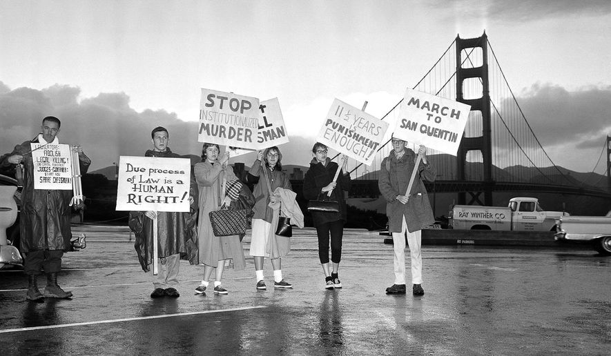 ADVANCE FOR USE MONDAY, MARCH 13, 2017 AND THEREAFTER-FILE - In this Feb. 18, 1960 file photo, college students protesting the execution of Caryl Chessman stand on the San Francisco side of the Golden Gate Bridge during a protest march to San Quentin Prison.  (AP Photo/File)