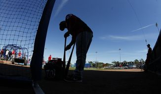 Washington Nationals catcher Derek Norris (23) gets ready for batting practice before a spring training baseball game against the New York Mets Saturday, March 11, 2017, in Port St. Lucie, Fla. (AP Photo/John Bazemore)