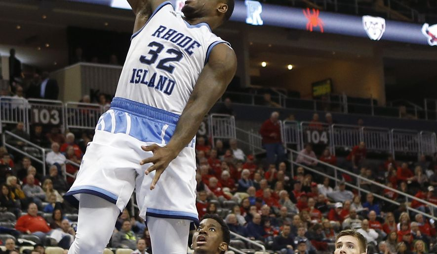 Rhode Island's Jared Terrell (32) dunks after getting by Davidson's Jon Axel Gudmundsson (3) during the second half of an NCAA college basketball game in the Atlantic 10 tournament semifinals Saturday, March 11, 2017, in Pittsburgh. Rhode Island won 84-60 to advance to the championship game. (AP Photo/Keith Srakocic)