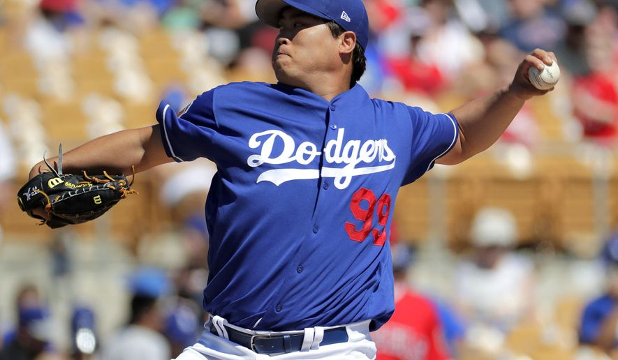 Los Angeles Dodgers starting pitcher Hyun-Jin Ryu (99) throws against the Los Angeles Angels during the first inning of a spring training baseball game, Saturday, March 11, 2017, in Phoenix. (AP Photo/Matt York)