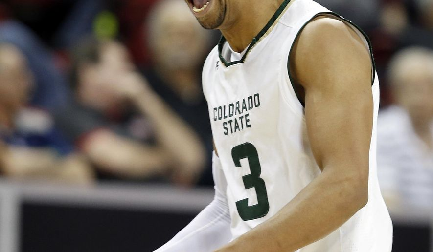 Colorado State's Gian Clavell reacts after sinking a 3-point shot during the first half of the team's NCAA college basketball game against San Diego State in the Mountain West Conference tournament semifinals Friday, March 10, 2017, in Las Vegas. (AP Photo/Isaac Brekken)