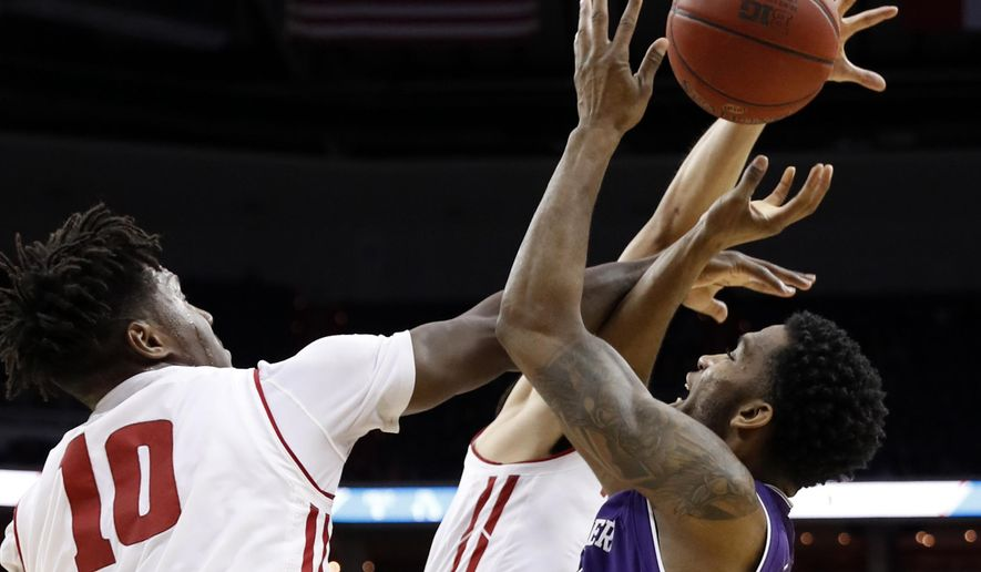 Wisconsin forward Nigel Hayes (10) and Wisconsin guard Bronson Koenig (24) combine to defend Northwestern forward Vic Law (4) during the first half of an NCAA college basketball game in the Big Ten tournament, Saturday, March 11, 2017, in Washington. (AP Photo/Alex Brandon)