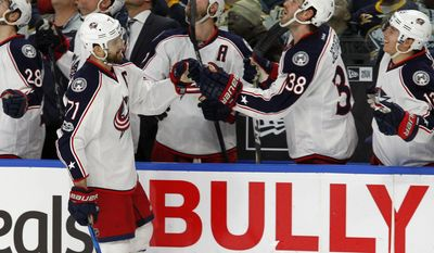 Columbus Blue Jackets forward Nick Foligno (71) celebrates his goal during the first period of an NHL hockey game against the Buffalo Sabres, Saturday, March 11, 2017, in Buffalo, N.Y. (AP Photo/Jeffrey T. Barnes)
