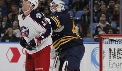 Buffalo Sabres goalie Robin Lehner (40) pushes Columbus Blue Jackets forward Scott Hartnell (43) during the second period of an NHL hockey game, Saturday, March 11, 2017, in Buffalo, N.Y. (AP Photo/Jeffrey T. Barnes)