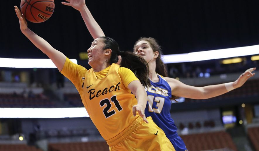 Long Beach State guard Anna Kim, front, goes up for a basket under defense by UC Santa Barbara forward Drew Edelman during the second half of an NCAA college basketball game for the championship of the Big West tournament Saturday, March 11, 2017, in Anaheim, Calif. Long Beach State won 56-55. (AP Photo/Jae C. Hong)