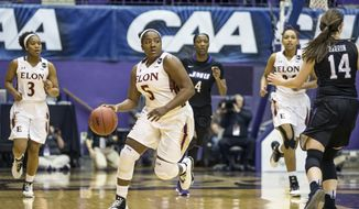 Elon Phoenix guard Shay Burnett (5) dribbles during the team's NCAA college basketball game against James Madison for the championship of the Colonial Athletic Association tournament in Harrisonburg, Va., Saturday, March 11, 2017. (AP Photo/Chet Strange)