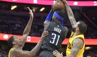 Cleveland Cavaliers guard Deron Williams, right, forces a jump ball on Orlando Magic forward Terrence Ross (31), while going up to shoot as Cavaliers forward Channing Frye, left, helps defend during the second half of an NBA basketball game in Orlando, Fla., Saturday, March 11, 2017.  (AP Photo/Phelan M. Ebenhack)