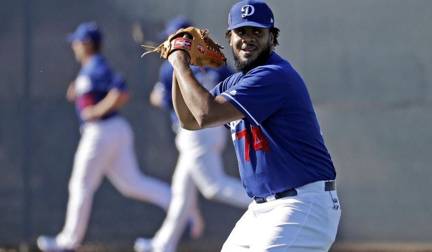 FILE - In this Feb. 16, 2017, file photo, Los Angeles Dodgers pitcher Kenley Jansen throws during a spring training baseball workout in Glendale, Ariz. On the off-season, the closer decided to stay with the Dodgers. (AP Photo/Morry Gash, File)