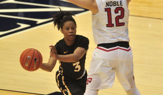 Southern Mississippi's Keri Jewett-Giles, left, looks to pass around Western Kentucky's Kendall Noble in an NCAA college basketball game in the championship of the Conference USA tournament, Saturday, March 11, 2017, in Birmingham, Ala. (AP Photo/Eric Schultz)