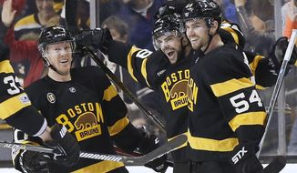 Boston Bruins' Drew Stafford, center, celebrates his goal with teammates Riley Nash (20) and Adam McQuaid (54) during the third period of an NHL hockey game against the Philadelphia Flyers in Boston, Saturday, March 11, 2017. The Bruins won 2-1. (AP Photo/Michael Dwyer)