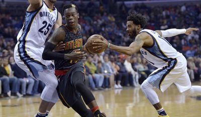Memphis Grizzlies guard Mike Conley, right, steals the ball from Atlanta Hawks guard Dennis Schroeder, center, as he drives against Grizzlies forward Chandler Parsons (25) during the first half of an NBA basketball game Saturday, March 11, 2017, in Memphis, Tenn. (AP Photo/Brandon Dill)