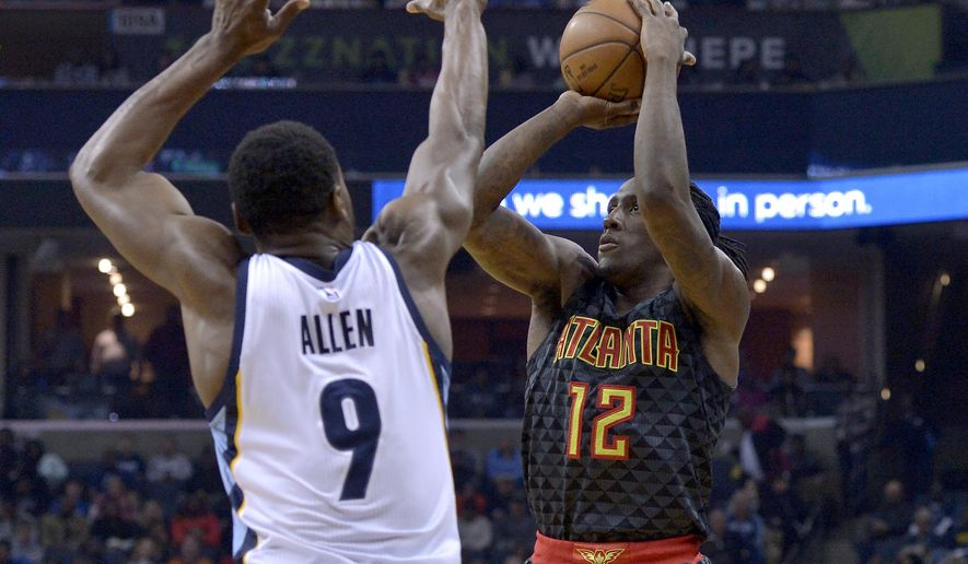Atlanta Hawks forward Taurean Prince (12) shoots against Memphis Grizzlies guard Tony Allen (9) in the first half of an NBA basketball game Saturday, March 11, 2017, in Memphis, Tenn. (AP Photo/Brandon Dill)