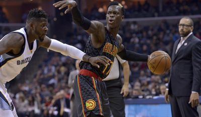 Atlanta Hawks guard Dennis Schroder (17) controls the ball against Memphis Grizzlies forward James Ennis, left, as Grizzlies head coach David Fizdale, right, looks on in the first half of an NBA basketball game Saturday, March 11, 2017, in Memphis, Tenn. (AP Photo/Brandon Dill)
